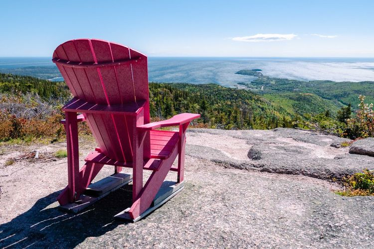 The red Canada 150 chair on Franey Mountain in Cape Breton, Nova Scotia, Canada Canada 150 Red Chair Absence Canada Chair Empty Environment Furniture Horizon Land Landscape Mountain Nature No People Outdoor Chair Outdoors Plant Relaxation Scenics - Nature Sea Seat Sky Tranquil Scene Tranquility Water