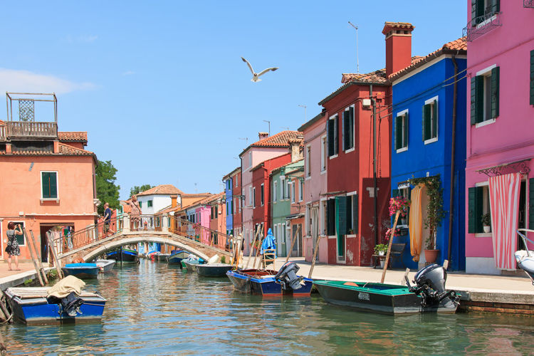 Burano canal, Venice Architecture Blue Boat Building Building Exterior Built Structure Burano, Italy Canal City Colored Day Houses Italy Mode Of Transport Nautical Vessel No People Outdoors Residential Building Residential Structure Sky Town Traditional Houses Venice, Italy Water Waterfront