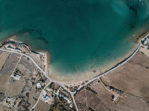 Aerial photo of a Mediterranean Coastline Coastline Coastal Drone Photography Aerial View Sea Ocean Road No People Arid Climate Greece Paros