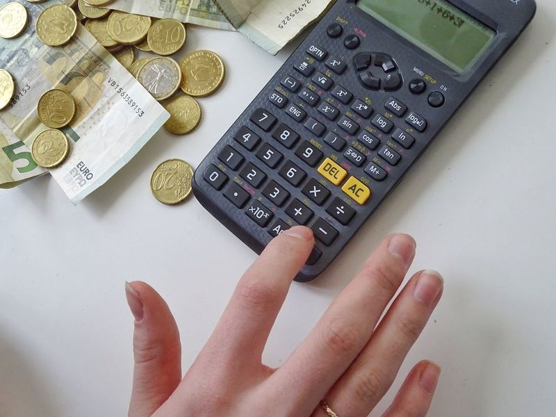 Finance Human Hand Calculator Human Body Part Human Finger Currency High Angle View Coin Indoors  One Person Close-up Day People Savings Paper Currency Wallet Euros Calculator Machine Currency Large Group Of Objects Table Money Financial Item