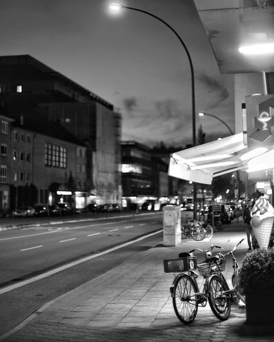 Cityscape Bnw Bicycle Icecream Shop Transportation City Architecture Street Mode Of Transportation Land Vehicle Built Structure Illuminated Building Exterior Road Night Incidental People Motor Vehicle Public Transportation Car Outdoors Lighting Equipment Sign Light
