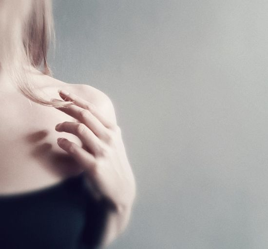 Rear view of woman hand against white background