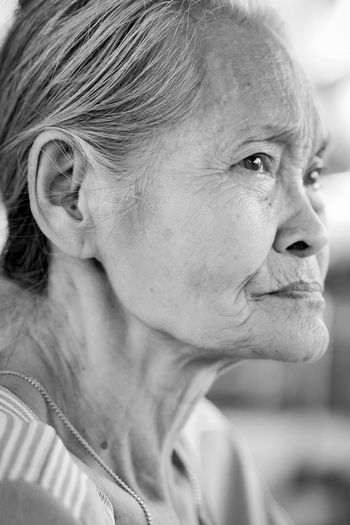 Close-up of thoughtful senior woman looking away