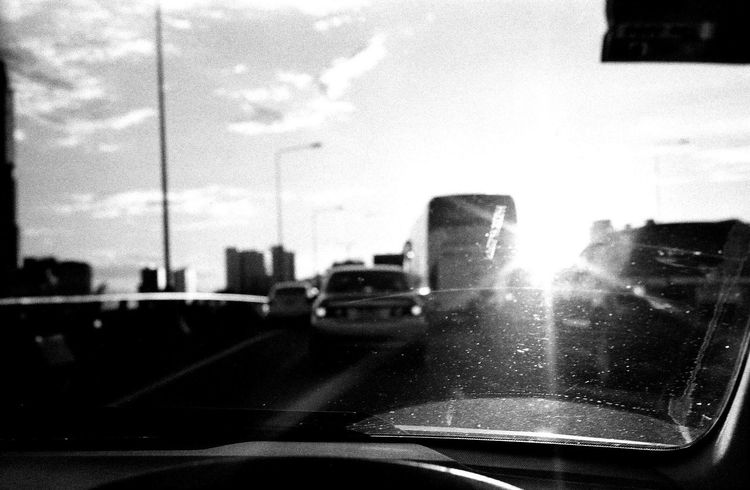 Rollei35SE Ilfordpan100 Transportation Windshield Road City Travel Film Photography Bkk Thailand B&w Filmphotography Traffic Traffic Jam City Life City Street Light And Shadow Sunlight And Shadow Sunlight, Shades And Shadows B&W Collection B&w Street Photography B&w Photography B&W Obsession Car Interior Life In Motion