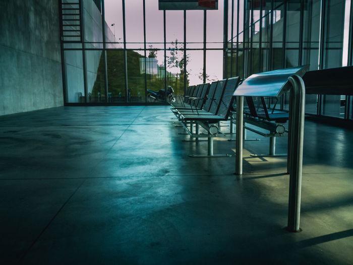 Empty seats on floor in waiting room