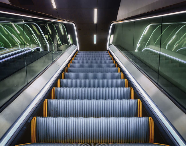 Low angle view of escalator at office