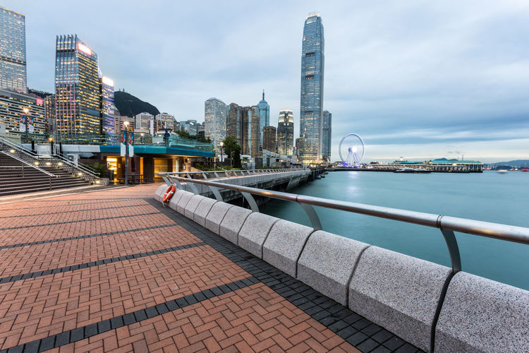Hong Kong business district cityscape ASIA Business Hong Kong Promenade Victoria Harbour Architecture Building Exterior Built Structure Business Finance And Industry City City Life Cityscape Hong Kong Island Illuminated Modern Office Building Exterior Outdoors Sky Skyscraper Travel Destinations Urban Skyline Water Waterfront