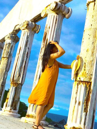 EyeEmNewHere Lifestyles Sky Yellow Sunlight Women Low Angle View Young Women Architectural Column Outdoors One Person Full Length Real People Princess Greecelookalike EyeEmNewHere