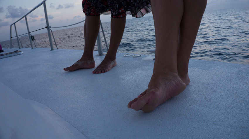 Barefoot Boat Catamaran Close-up Day Dusk Holiday Human Body Part Human Leg Lifestyles Low Section Luxury Men Nature Outdoors People Real People Sea Standing Travel Destinations Two People Vacations Water Women Let's Go. Together.