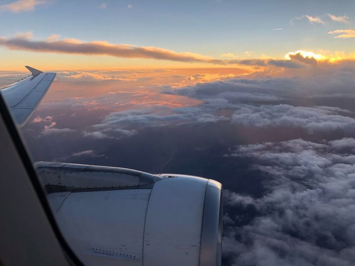 EyeEmNewHere Aviationlovers Aviationphotography Aviation Swiss Flyswiss Air Vehicle Mode Of Transportation Transportation Sunset Nature Travel Engine Airplane Flying Aircraft Wing Travel Sky Cloud - Sky