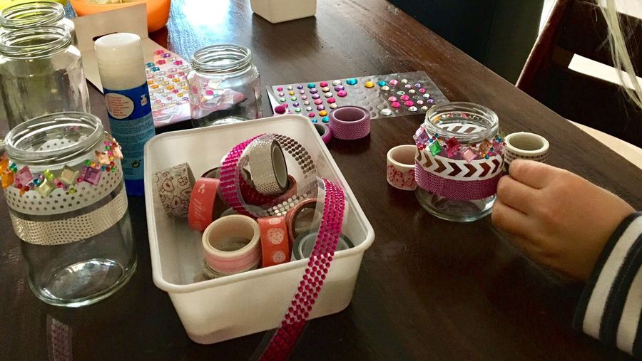 Handmade For You making Candleholders from empty Jars  Glitters Bling Bling Glass Handcraft Printed Tape Tape Paste Indoors  Table Human Hand Real People Close-up Craft Supplies