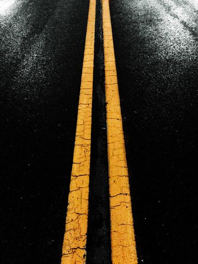 Taking Photos IPhoneography Night Road Road Marking Sign Marking Symbol Asphalt Transportation Yellow The Way Forward No People High Angle View City Communication Direction Guidance Day Double Yellow Line Street Outdoors