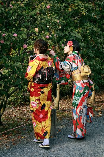 Japanese Girls in Kimono Garden Kimono Streetphotography Girl Kyoto Japan Real People Day Plant Rear View Costume Group Of People Adult Nature Clothing Lifestyles Women Outdoors People Traditional Clothing Floral Pattern