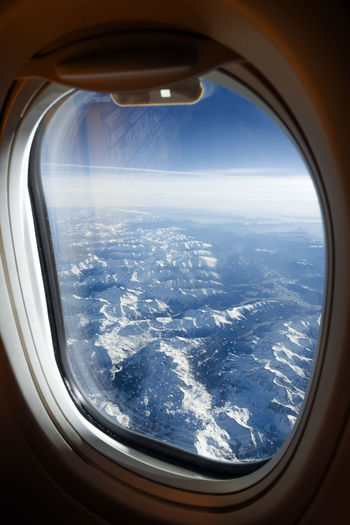 A perfect View for a Holiday Winter From The Plane Window Mountains Airplane Blue Sky Snow Cold Temperature Resort Window Freezing Ice Skiing Resort Linas Was Here
