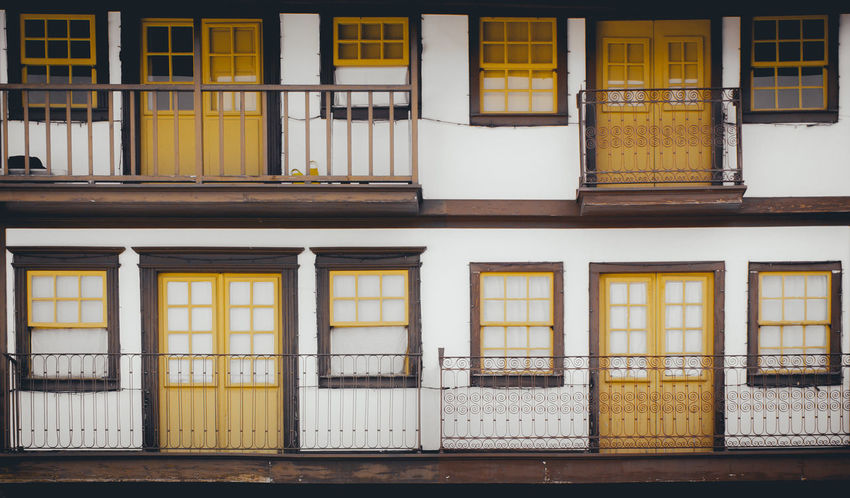 To each their own Doors Façade Architecture Building Exterior Built Structure Day Facades No People Outdoors Window Yellow Paint The Town Yellow
