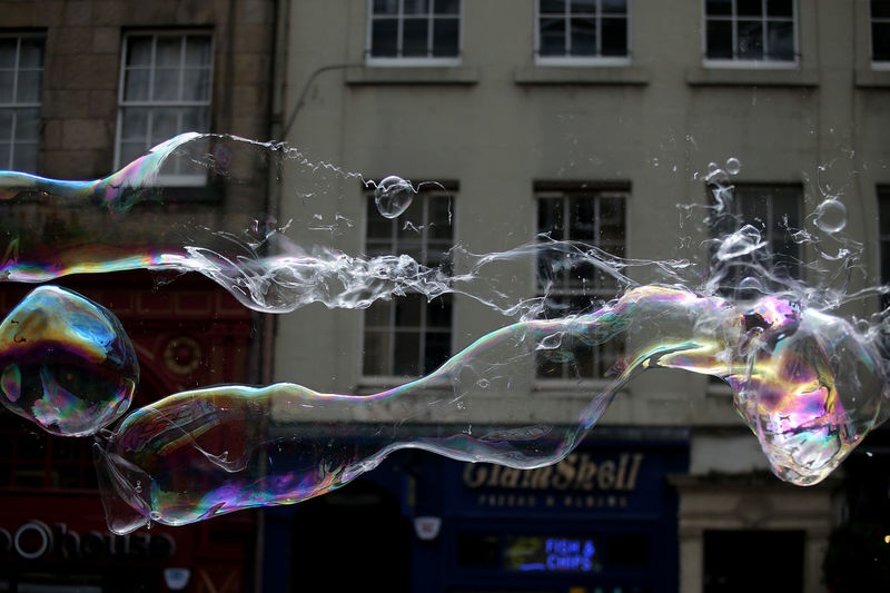 Multi colored bubbles against buildings in city