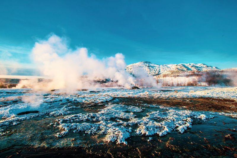 Geyser Iceland Hot Springs Hot Spring Travel Destinations Iceland Sky Motion Nature Power In Nature Day No People Blue Water Power Beauty In Nature Outdoors Geology Splashing Scenics - Nature Heat - Temperature Erupting Land Sea Non-urban Scene Pollution