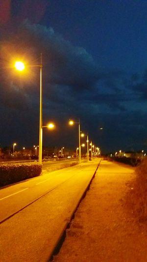 The street by night. Street Light Road Street Night Long Sky Cloud Outdoors Dark Empty Road The Way Forward