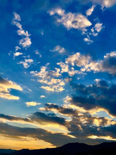A Beautiful Sunset Sky. (180916-181014) Cloud - Sky Sky Beauty In Nature Scenics - Nature Tranquility Tranquil Scene Sunset Nature Environment Non-urban Scene Dramatic Sky Blue Idyllic Sunlight Silhouette Outdoors No People Low Angle View