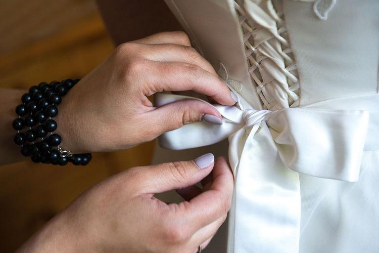 Bridesmaid Fashion Ribbon Wedding Wedding Photography Body Part Bridal Close Up Hand Holding Human Body Part Human Finger Human Hand Real People Style Wedding Ceremony Wedding Day Wedding Dress