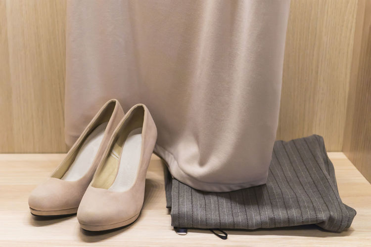 Close-up of dress and shoes on floor