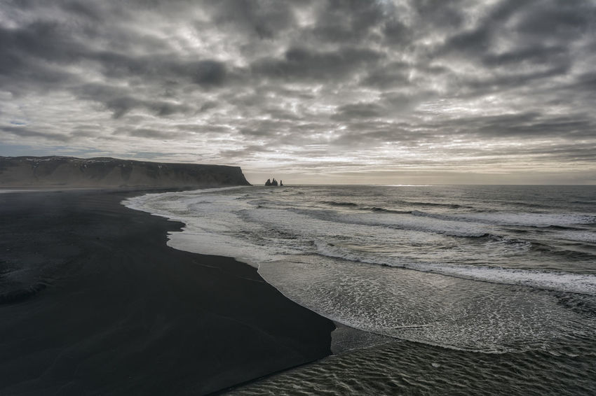 Landscape in Iceland Beach Beauty In Nature Cloud Cloud - Sky Cloudy Coastline Dramatic Sky Horizon Over Water Idyllic Nature Non-urban Scene Outdoors Overcast Remote Scenics Sea Seascape Shore Sky Sunset Tranquil Scene Tranquility Water Wave Weather