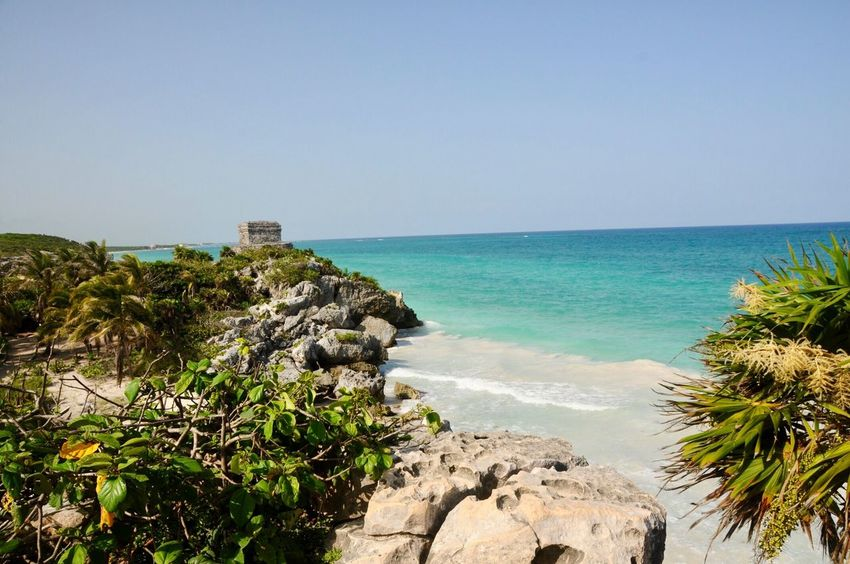 Tulum Beach Old Ruin Tulum , Rivera Maya. Tulum Beach Sea Clear Sky Copy Space Horizon Over Water Scenics Water Nature Blue Beauty In Nature Outdoors Rock - Object Built Structure Day No People Tranquility Architecture Sky Tourist Viajando Mexico This Is Latin America