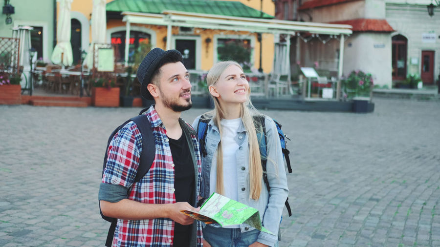 Young couple standing in city