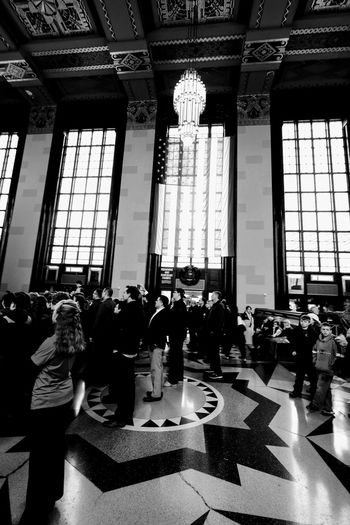 Visual Journal December 2016 - American Postal Workers Union Christmas Party at Union Station Durham Museum Omaha, Nebraska (Fujifilm Xt1,Fuji 10-24/f4 OIS) edited with Google Photos. 10-24mmWideAngle A Day In The Life Art Deco Architecture B&w B&w Photography Camera Work Ceiling Ceiling Christmastime Event Fujifilm_xseries Historical Building Indoors  Indoors  Large Group Of People People Photo Diary Real People Storytelling Union Station Omaha Vertical Visual Journal Wide Angle Windows Winter