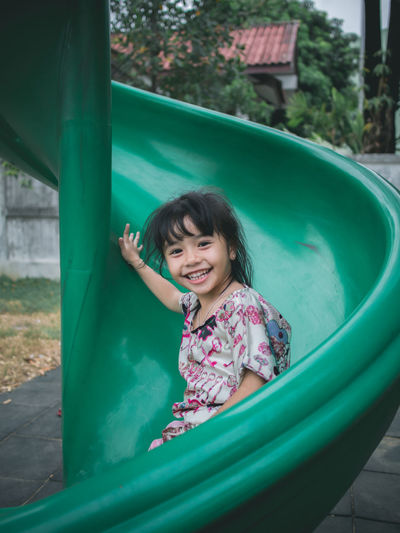 Cute little asian girl having smile on slide Childhood Child Girls One Person Real People Enjoyment Happiness Playground Females Leisure Activity Smiling Innocence Fun Day Playing Slide - Play Equipment Women Lifestyles Portrait Outdoor Play Equipment Outdoors Inflatable  Swimming Pool