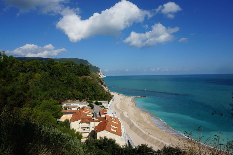 Beautiful view of adriatic sea from.numana, italy during summer on sunny day with blue and cloud sky