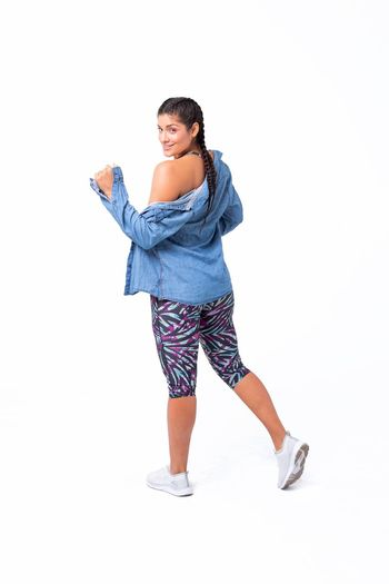 Studio Shot Standing White Background Casual Clothing Women Lifestyles Fitness Fitness Clothing Fitnessmodel Fitness Model Fit Woman Colorful Cute Happy Happiness Dacing Urban Clothing Casual Look Make Up Jean Jacket Active Wear Sportive Zumba Brown Hair Beautiful Woman