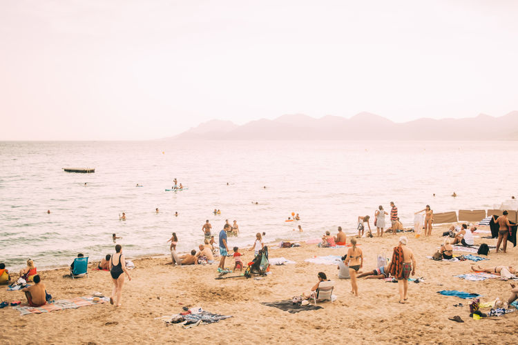 Cannes France Beach Crowd Group Of People Holiday Large Group Of People Sand Sea Summer Sun Sunset Travel Water
