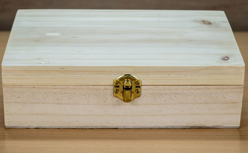 Close-up of wooden box on table