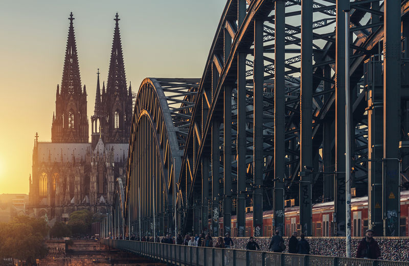 View of the Cologne Cathedral at sunset Cathedral Cologne Old Town Sunlight Travel Traveling Bridge Cologne Cathedral Germany Hohenzollernbrücke Landmark Light And Shadow Mood Pedestrian Religion Sunrise Sunset Tourism Train Train Station Travel Destination Travel Destinations