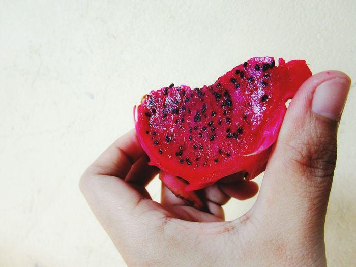 Cropped Image Of Person Holding Pitaya