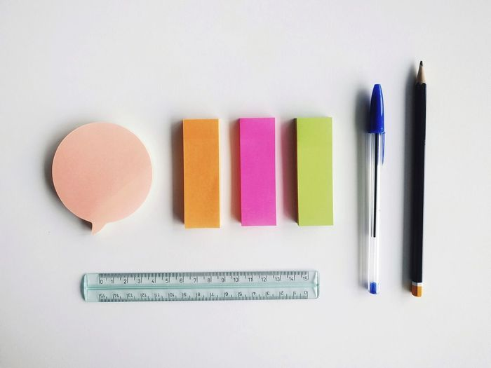Office essentials. Pencil Multi Colored Office Supply Paper Studio Shot White Background Office Education Indoors  Close-up No People Postit Adhesive Note Office Environment Workdesk Study Workplace Place Of Work Desk Working Office Things Organized Neatly