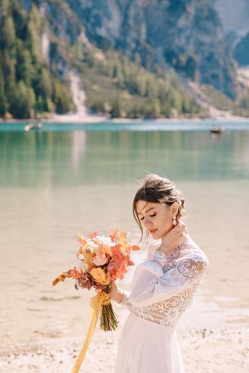 Beautiful woman standing by lake