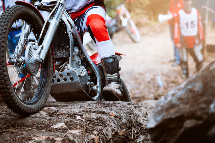Man racing on bike in forest