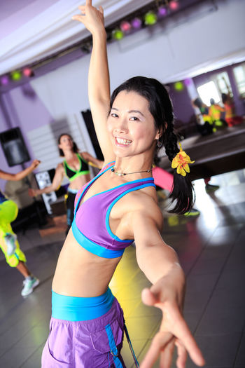 Smiling woman exercising in gym