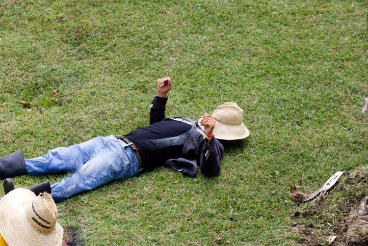 Taking a siesta on the grass Lying Down Grass Plant Lying On Back One Person Full Length High Angle View Day Nature Men Casual Clothing Young Adult Adult Relaxation Outdoors Field Leisure Activity Clothing Land