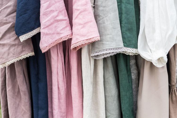 Full frame shot of multi colored dresses hanging for sale at market