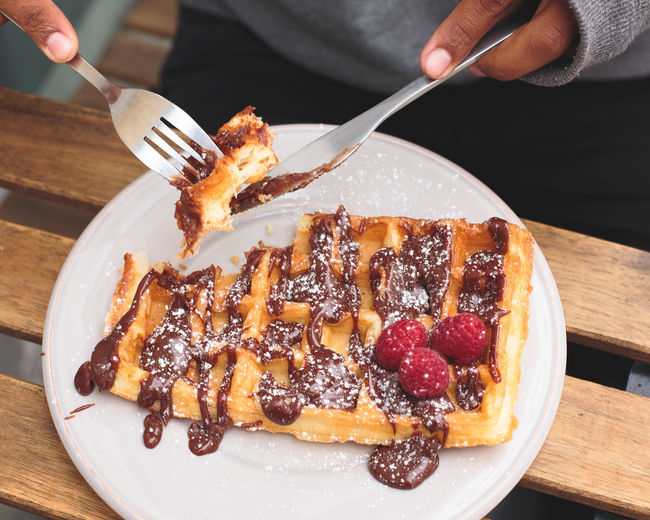 Waffle Close-up Day Dessert Food Food And Drink Fork Freshness Holding Human Body Part Human Finger Human Hand Indoors  Indulgence One Person People Plate Ready-to-eat Real People Serving Size Stuffed Sweet Food Table Temptation Unhealthy Eating