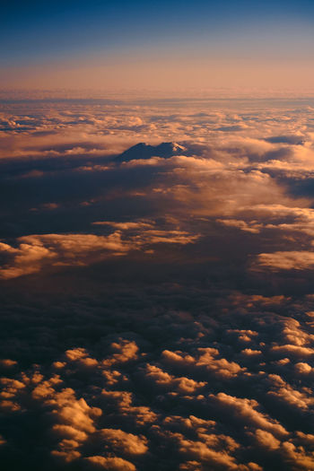 Aerial Shot Cloudscape Above Aerial View Backgrounds Beauty In Nature Cloud - Sky Clouds And Sky Cloudscape Dramatic Sky Fluffy Go Higher Heaven Idyllic Majestic Meteorology Mountain Mountains Nature No People Orange Color Outdoors Scenics - Nature Sky Sunset Tranquil Scene Tranquility