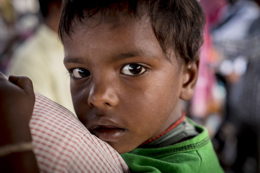 Close up shot of a young boy being carried by his father at Sonepur Mela, Bihar Bihar Child Childhood Close-up Facial Expression Hajipur Headshot Human Face India Infant One Person Outdoor Photography Outdoors Portrait Sonepur Sonepurmela Stare Travel Travel Photography