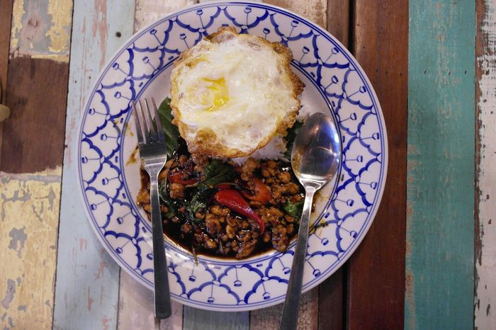 Food And Drink Food Ready-to-eat Plate Indoors  Healthy Eating Table Serving Size Freshness No People Close-up Day Rice Chicken Meat Spicy Food Spicy Thai Food Thai Cuisine Basil Leaves Fried Egg