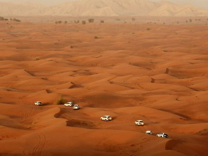 High angle view of sport utility vehicles at desert