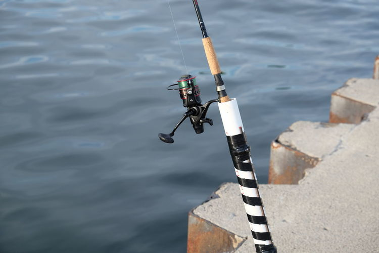 Lake Michigan Activity Cane Day Detail Dock Fishing Fishing Rod High Angle View Leisure Activity No People Outdoors Sea Sunlight Water