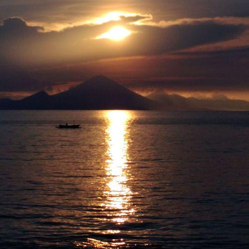 Sunset Shillouette DELTA API Rumahalir Lombok-Indonesia Small Island Water Mountain Sea Sunset Gold Colored Sunlight Sun Reflection Dramatic Sky Seascape Island