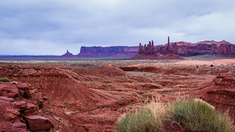 Arid Climate Beauty In Nature City Day Desert Landscape Monument Valley Tribal Park Nature No People Outdoors Sand Scenics Sky Storm Cloud